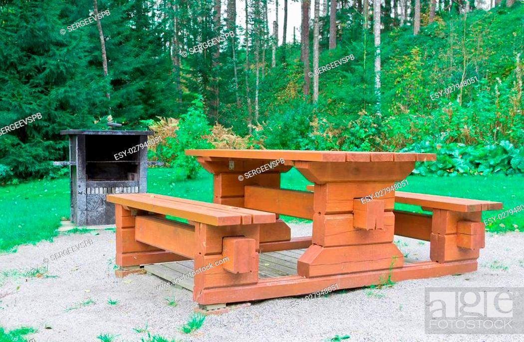 Stock Photo: garden wooden table with benches.