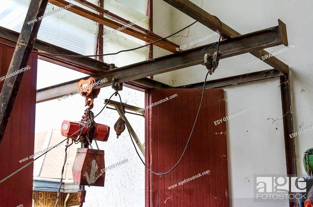 Stock Photo: Abandoned crane with pulley.