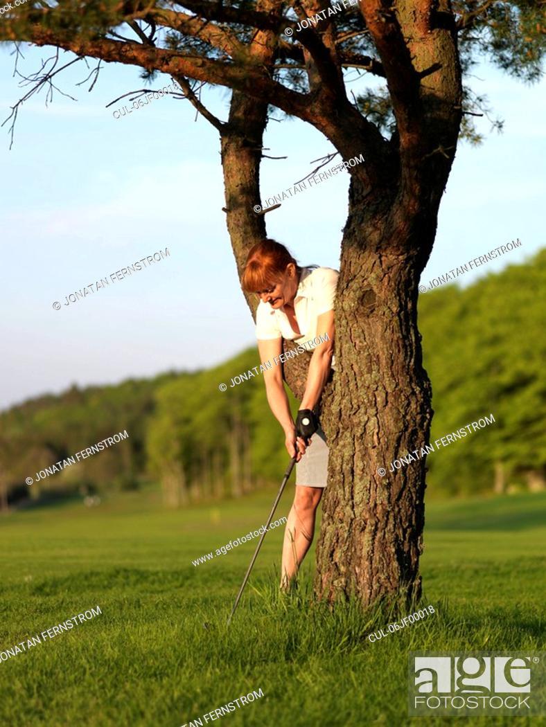 Stock Photo: Woman hitting golf ball.