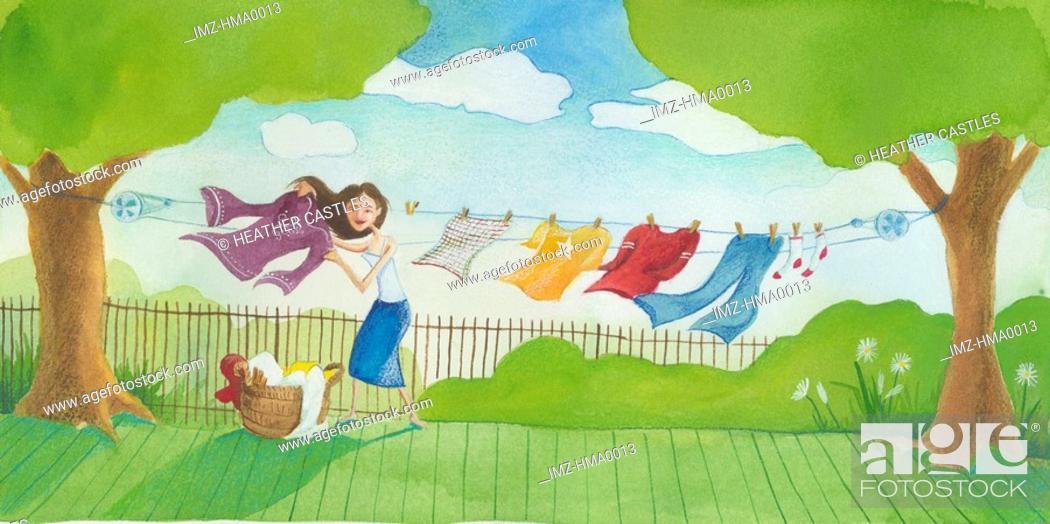 Stock Photo: woman hanging laundry outside.