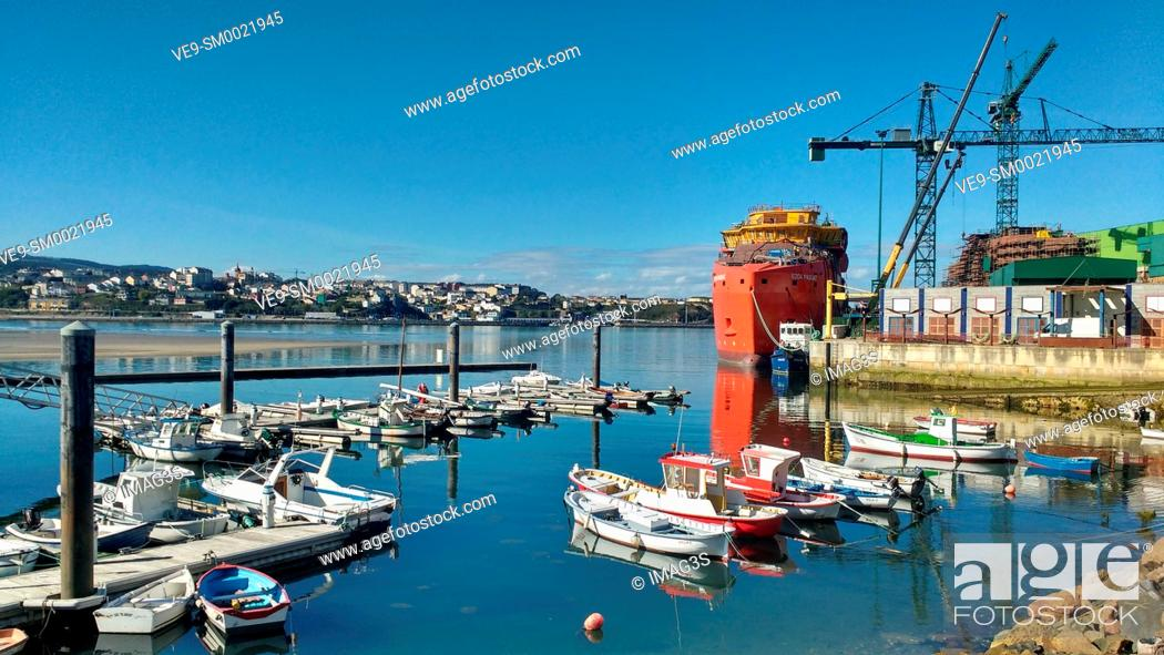 Stock Photo: Figueras port and a SOV (Service Operation Vessel), being built at Gondán shipyard in backgound, Asturias, Spain.
