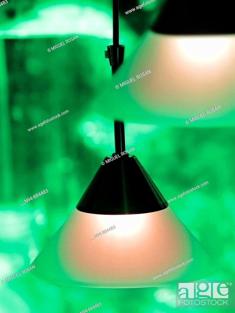 Stock Photo: Tulipa glass cone lamp alógena, hung from the ceiling.