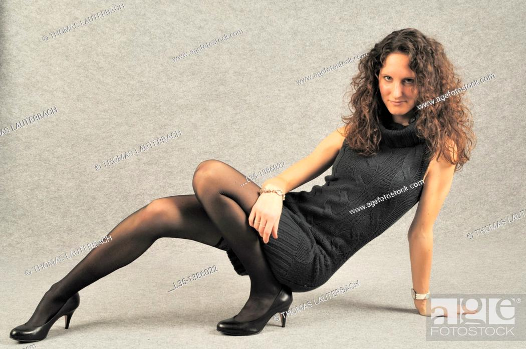 Stock Photo: Young woman with very long legs.
