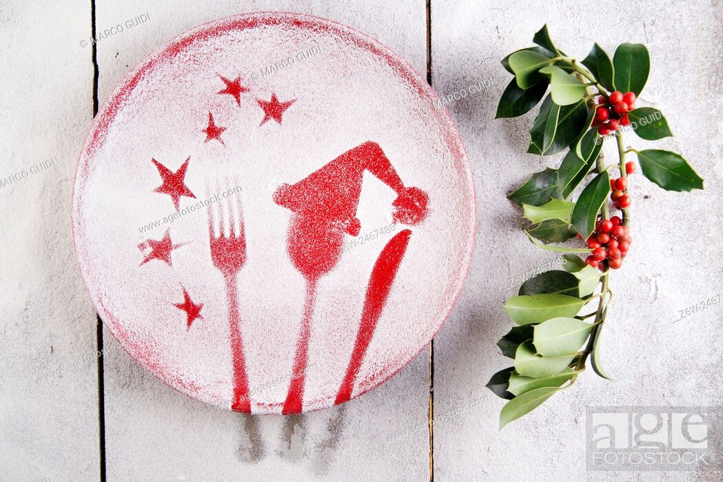 Stock Photo: Representation of the Christmas holiday with cutlery on red dish and sprinkle with flour.