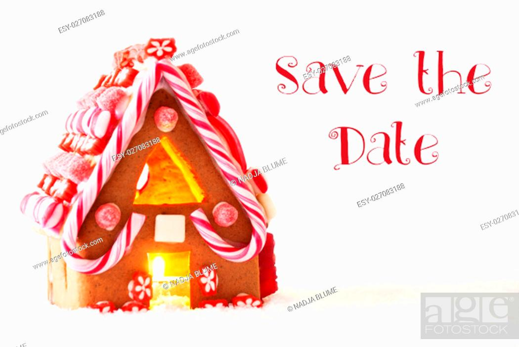 Stock Photo: English Text Save The Date. Gingerbread House In Snowy Scenery As Christmas Decoration With White Background. Candlelight For Romantic Atmosphere.