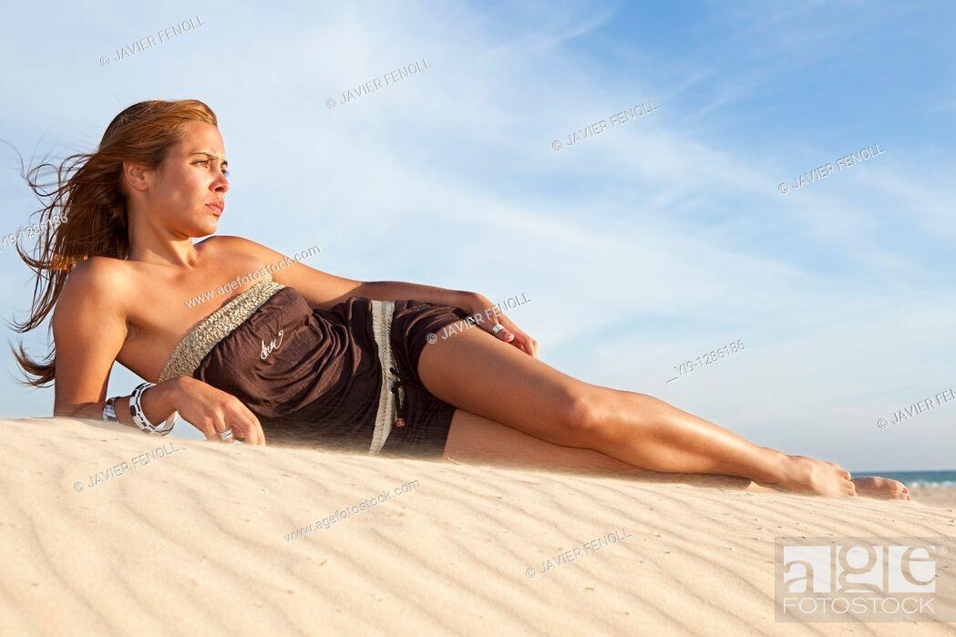 Stock Photo: Beautiful woman posing on the beach.