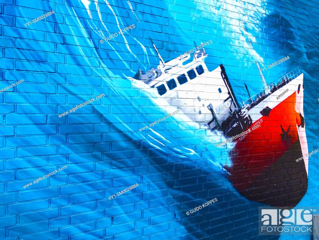 Stock Photo: Rotterdam, Netherlands. Huge Mural & Graffity of a fishing vessel being thrusted by a Huge, killer wave, somewhere out on the North Sea.