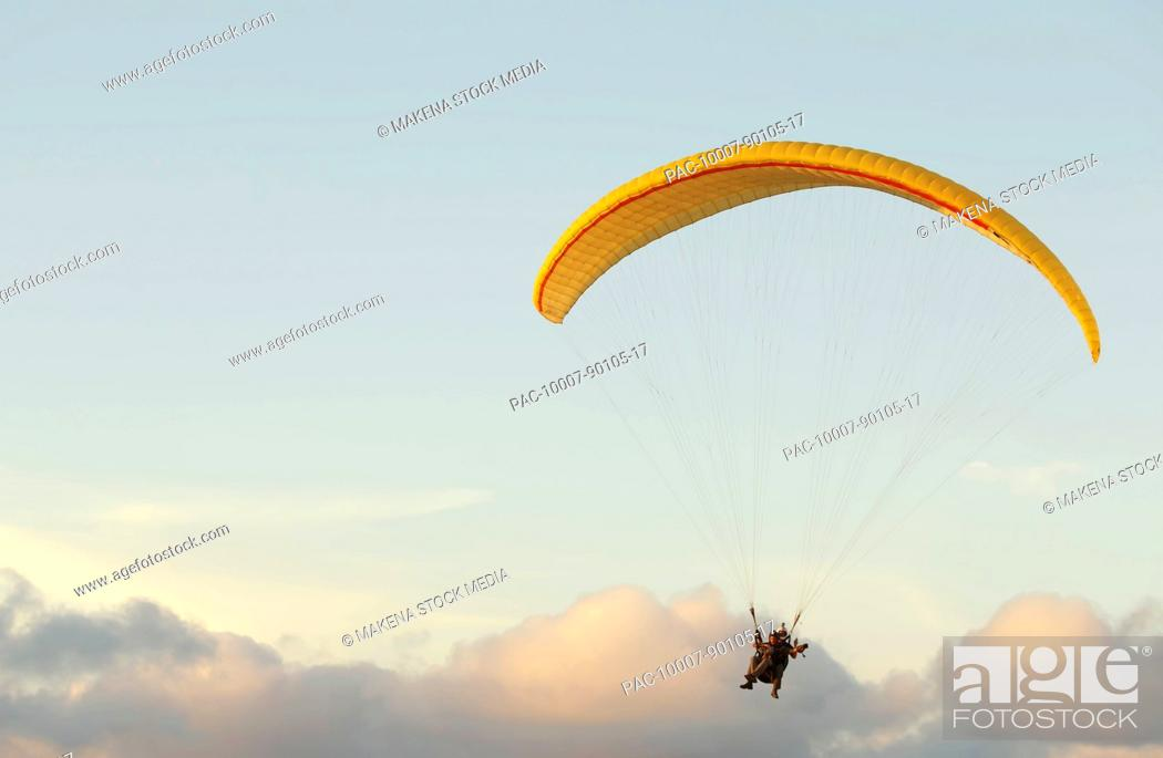 California, La Jolla, Paraglider flying near clouds  FOR