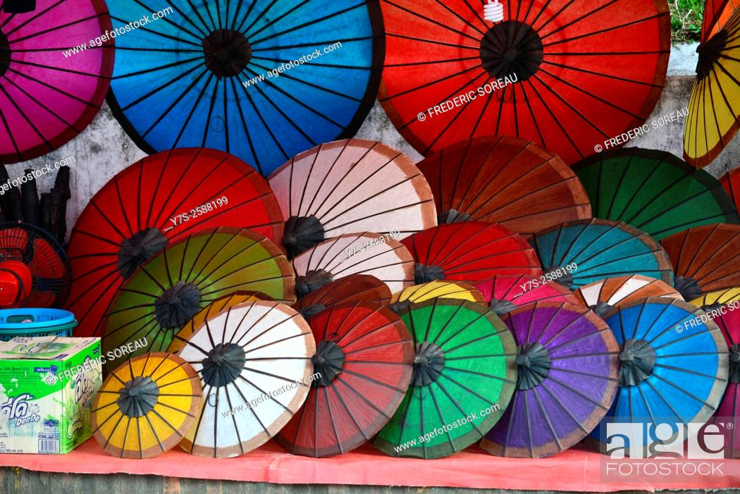 Stock Photo: Colorful handmade Asian umbrellas on display at night market in Luang Prabang, in Laos, South East Asia.