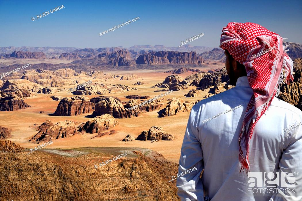 Stock Photo: Bedouin and view from the summit of Jebel Umm Adaami (1832m), the highest mountain of Jordan. Jordan, Wadi Rum desert, border with Saudi Arabia.