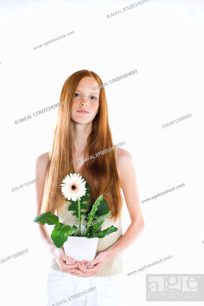 Stock Photo: young woman with potted flower.