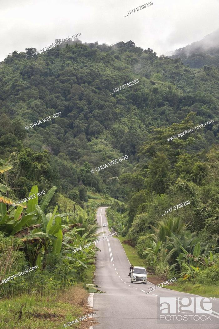 Stock Photo: A road to Borneo Highlands, Padawan, Sarawak, East Malaysia.