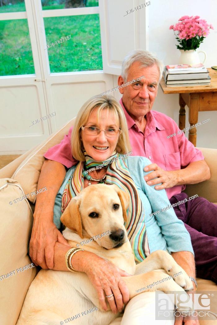 Stock Photo: Senior couple with dog.