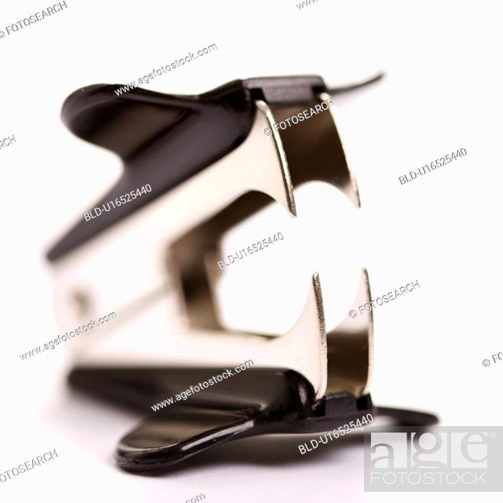Stock Photo: Staple remover on white background with selective focus.