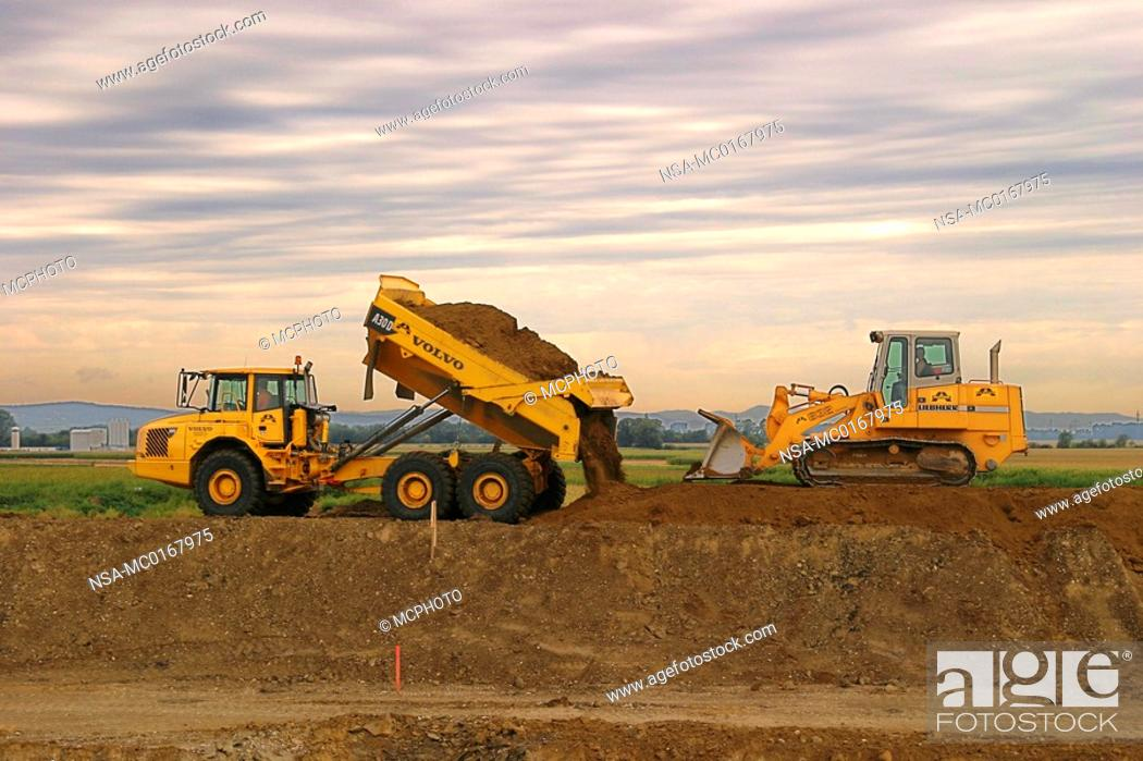 Stock Photo: Crawler-type vehicle and truck on a building site.