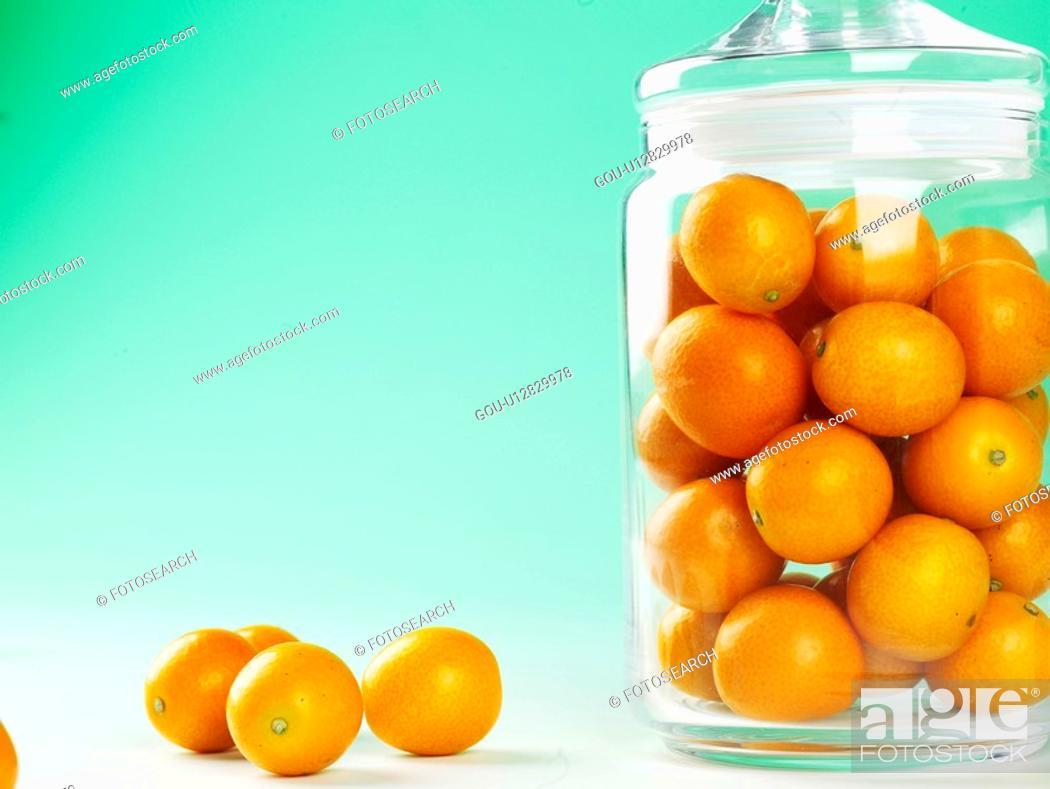 Stock Photo: fruit, glassware, plants, plant, glass jar, oval kumquat.