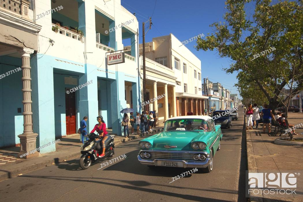 Stock Photo: Cyclist and cars in front of the colonial buildings at Paseo Del Prado or so-called Boulevard, Cienfuegos, Cienfuegos Province, Cuba, West Indies.