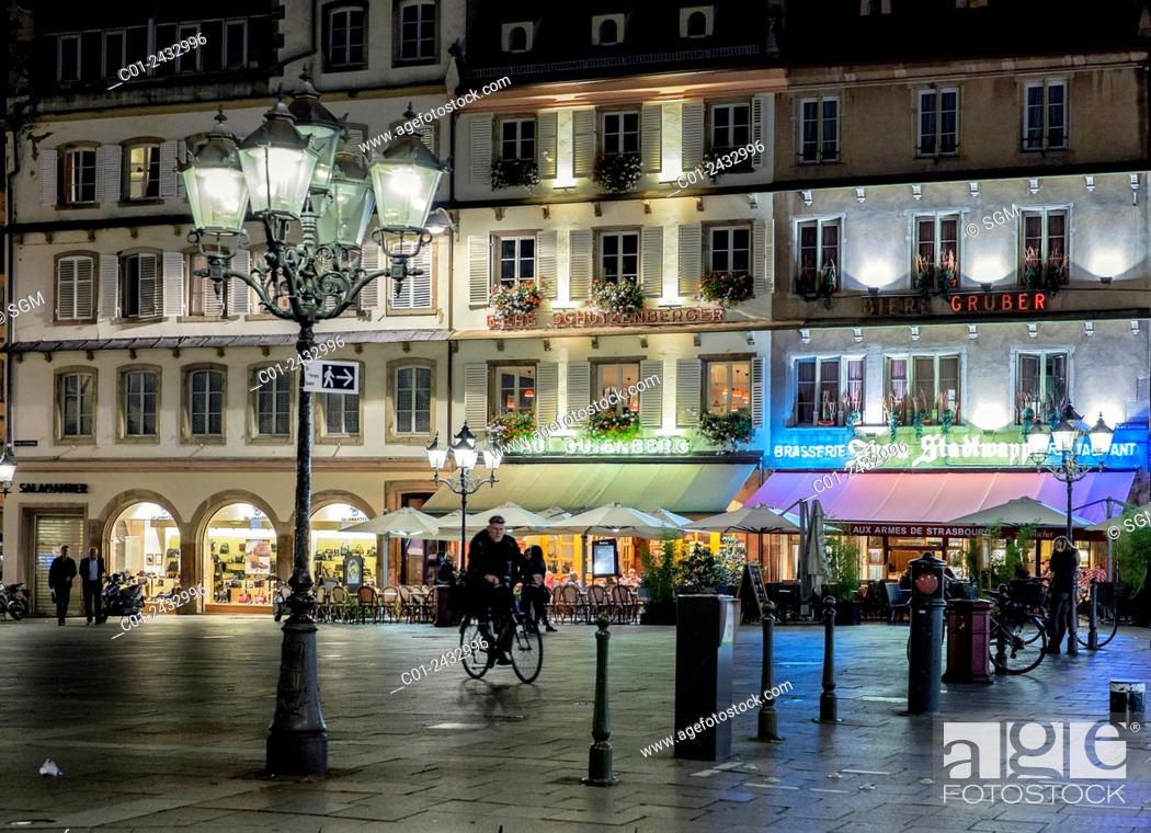 Stock Photo: Gutenberg square with restaurants at night Strasbourg Alsace France.