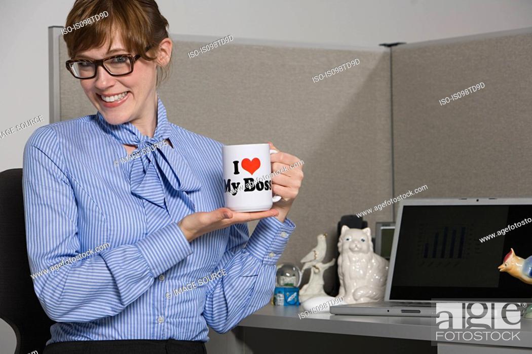 Stock Photo: Businesswoman holding slogan mug.