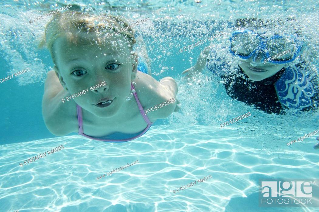 Stock Photo: Boy and girl swimming.