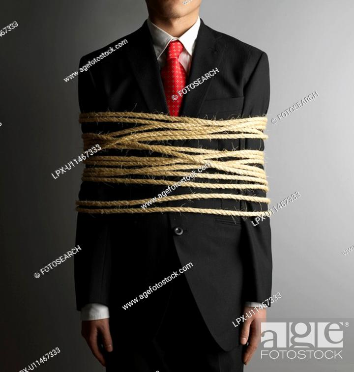 Stock Photo: Businessman Tied with Rope.