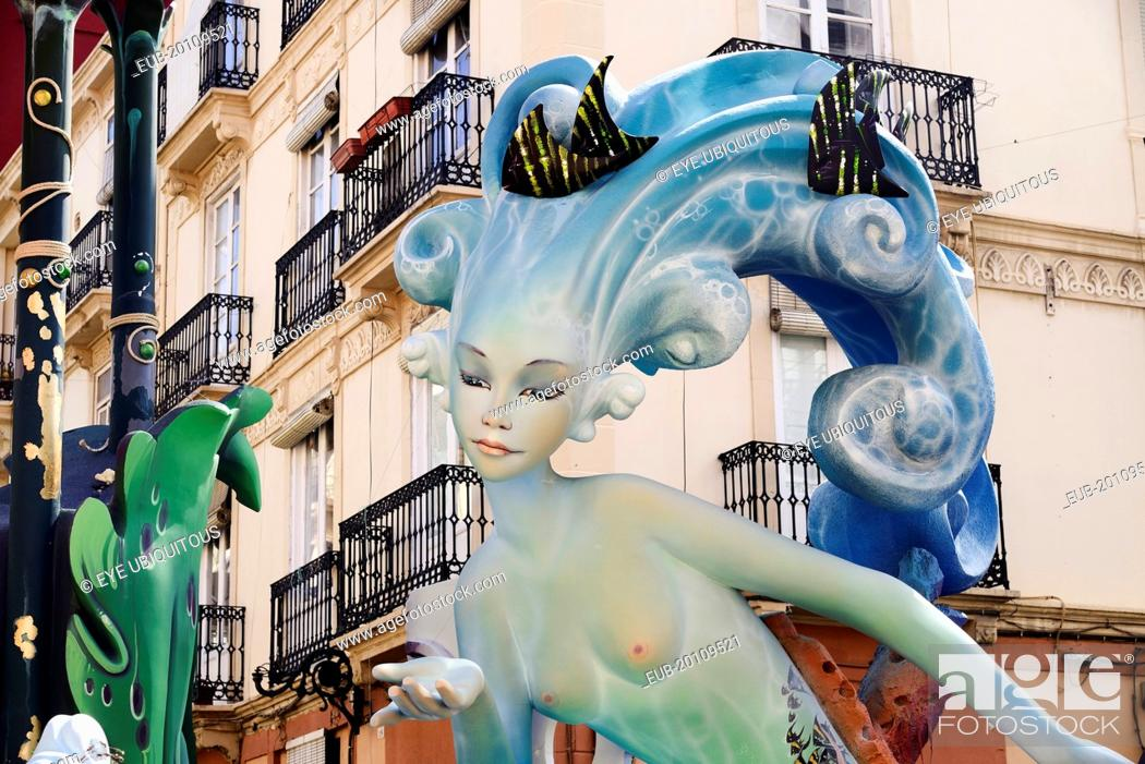 Stock Photo: Papier Mache figure of mermaid in the street during Las Fallas festival.