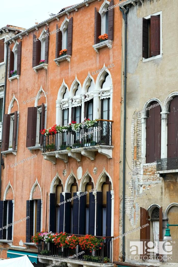 Stock Photo: Window boxes hanging on the railings of windows, Venice, Italy.