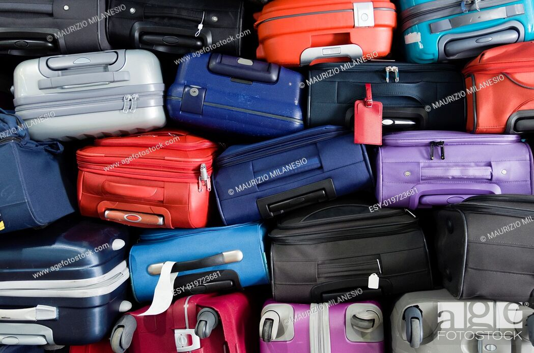 Stock Photo: Suitcases multicolor stacked for transport one above the other.