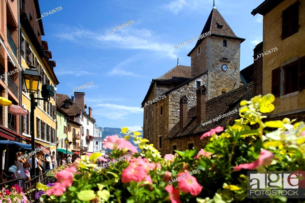 Stock Photo: The Palais (palace) de l'Ile and the flowers of the riverside. Annecy. France.