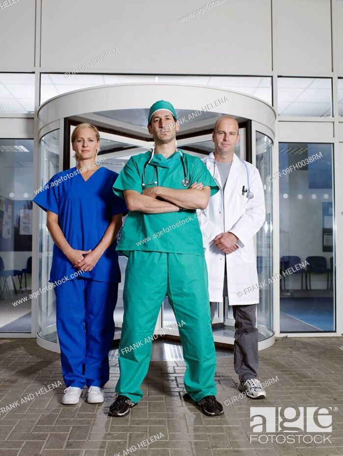 Stock Photo: Hospital team in front of entrance.