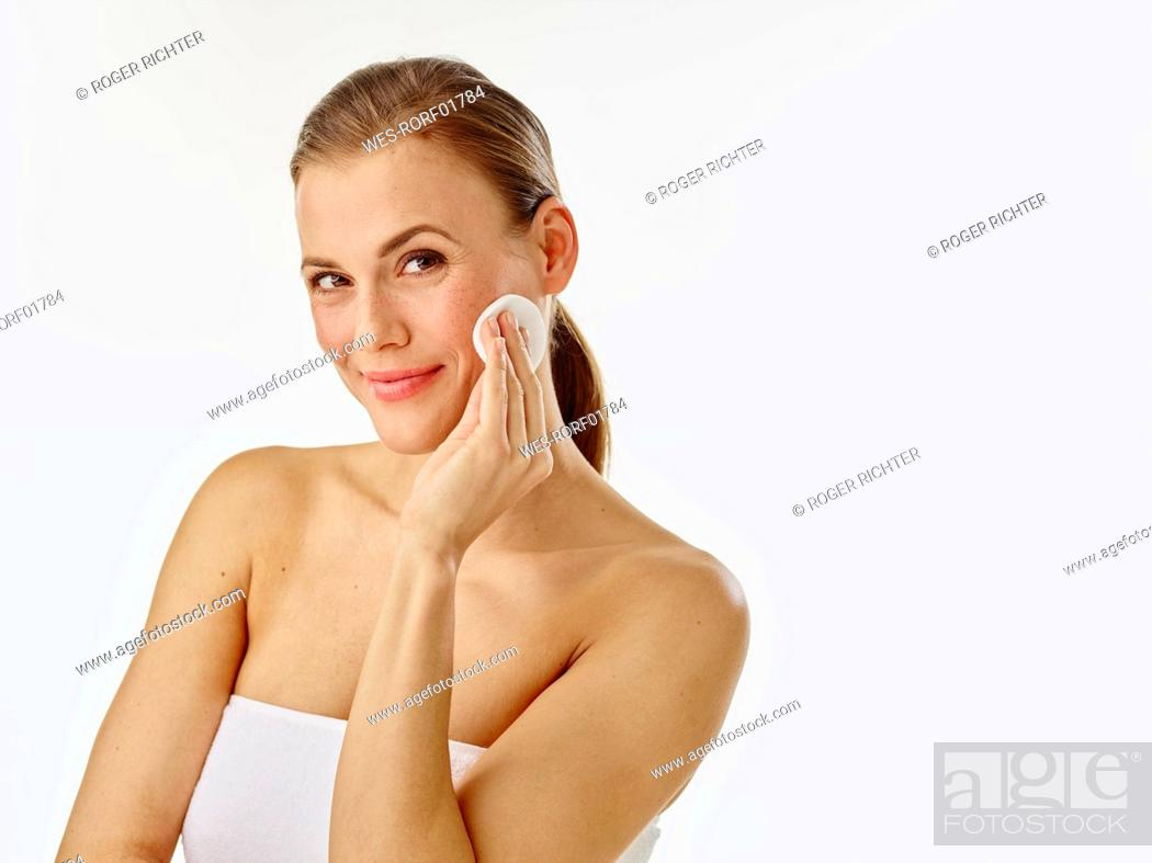 Stock Photo: Young woman using cotton pad.