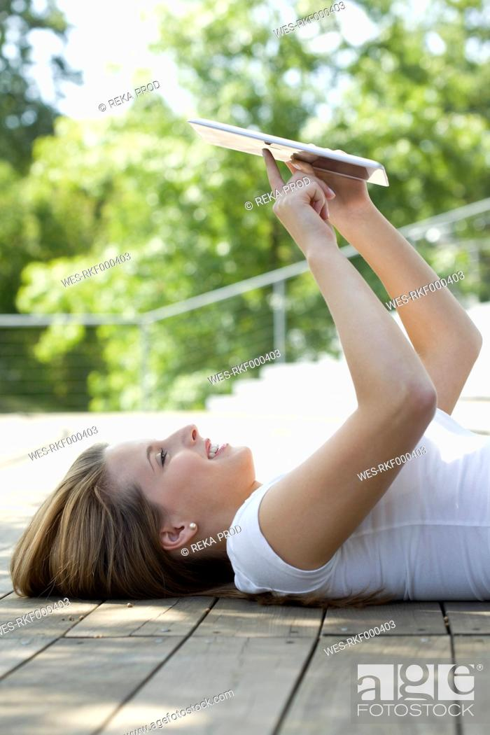 Stock Photo: Europe, Germany, North Rhine Westphalia, Duesseldorf, Young student with digital tablet, smiling.