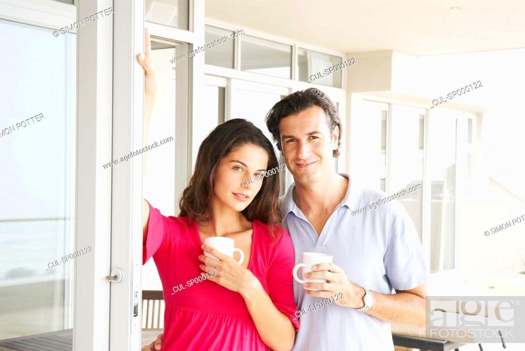 Stock Photo: Couple at home looking relaxed, smiling.