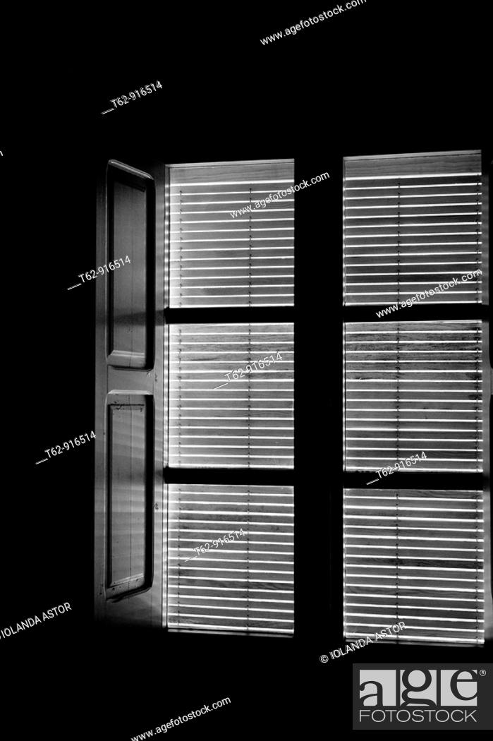Stock Photo: Window with the blinds down  View from inside  Black and white  Conceptual.