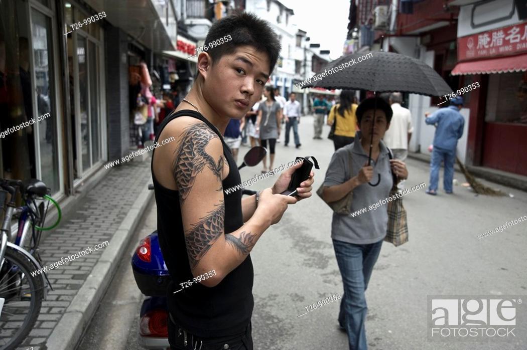 Stock Photo: tattooed guy looks at the camera.
