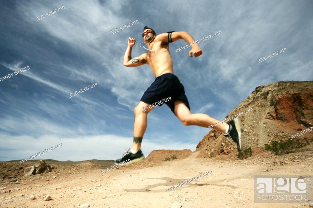 Stock Photo: Caucasian man in shorts running.