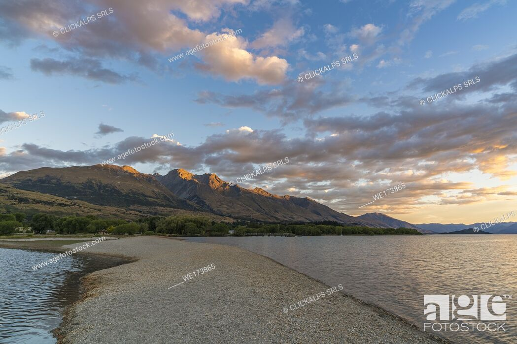 Stock Photo: Clouds in the sky above Lake Wakatipu and mountains at sunset. Glenorchy, Queenstown Lakes district, Otago region, South Island, New Zealand.