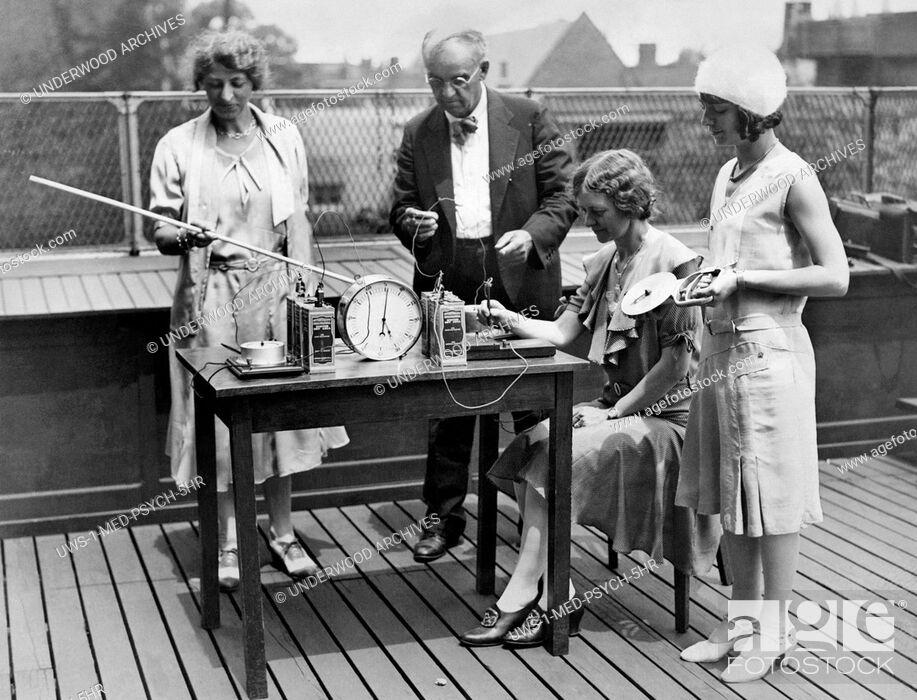 Stock Photo: Philadelphia, Pennsylvania: c. 1929 Temple University psychologist Dr. Thaddeus Bolton at work doing tests to determine the ambidextrous ability of his students.