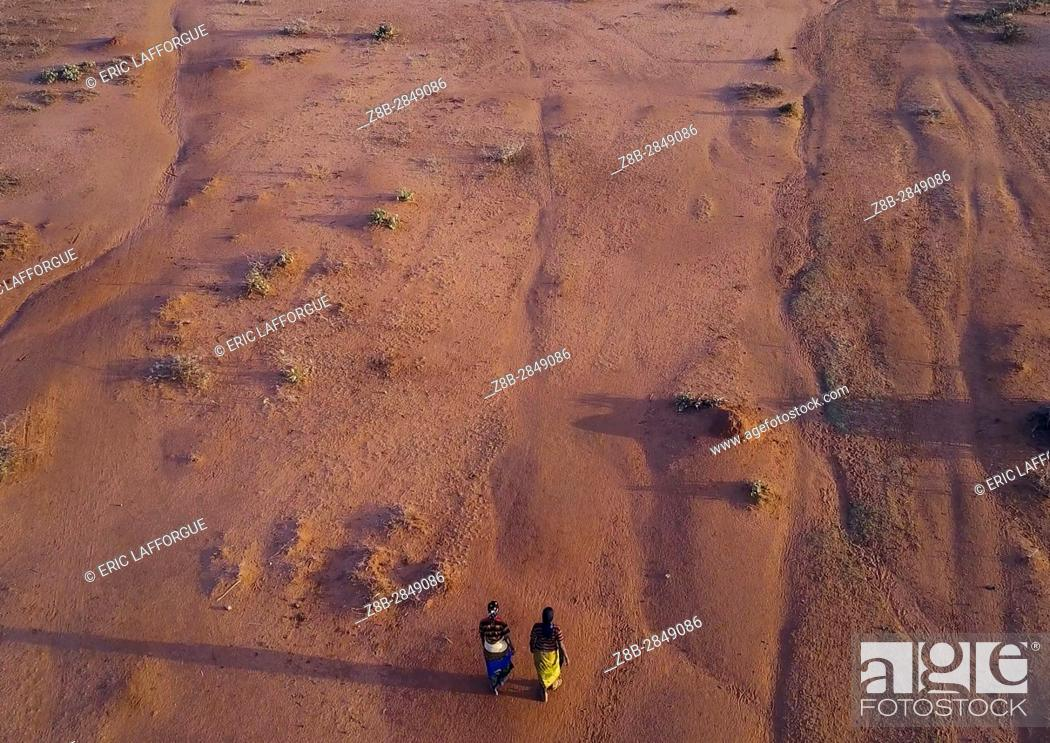 Stock Photo: Aerial view of two women waliking in an arid area, Oromia, Yabelo, Ethiopia.