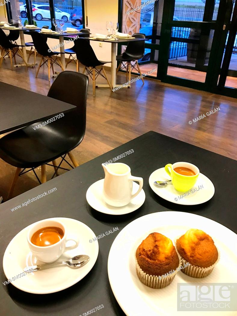 Stock Photo: Two cups of coffee and muffins in a cafeteria. Spain.
