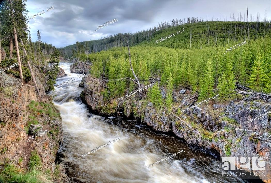 Stock Photo: The Firehole River rushes through the Firehole Canyon at Yellowstone National Park, Wyoming.
