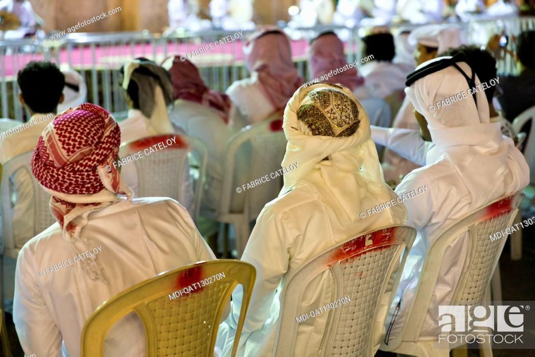 Stock Photo: Qatar - Doha - Souq Waqif - Qatari attending an outdoor concert.