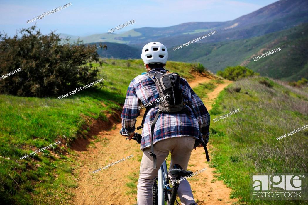 Stock Photo: Cyclist mountain biking, San Luis Obispo, California, United States of America.