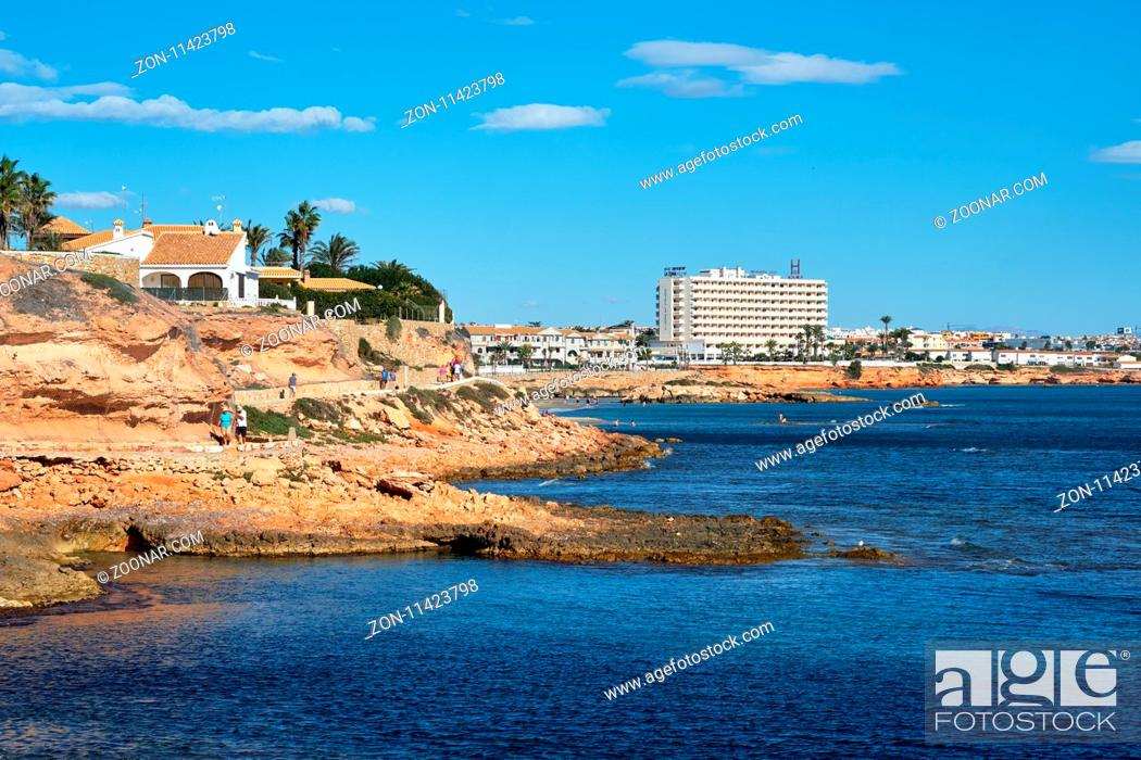 Stock Photo: Orihuela, Spain - November 5, 2017: Rocky coastline of Cabo Roig, popular place for holidaymakers. Situated in between La Zenia to the north and Campoamor to.