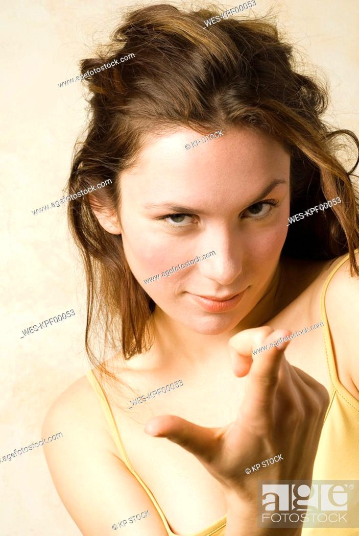 Stock Photo: Young woman, gesturing, portrait, close up.