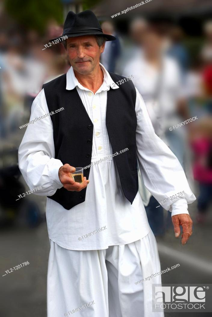Stock Photo: People in tradtional Hungarian costume celebrating the wine festival - Badascony, Hungary.