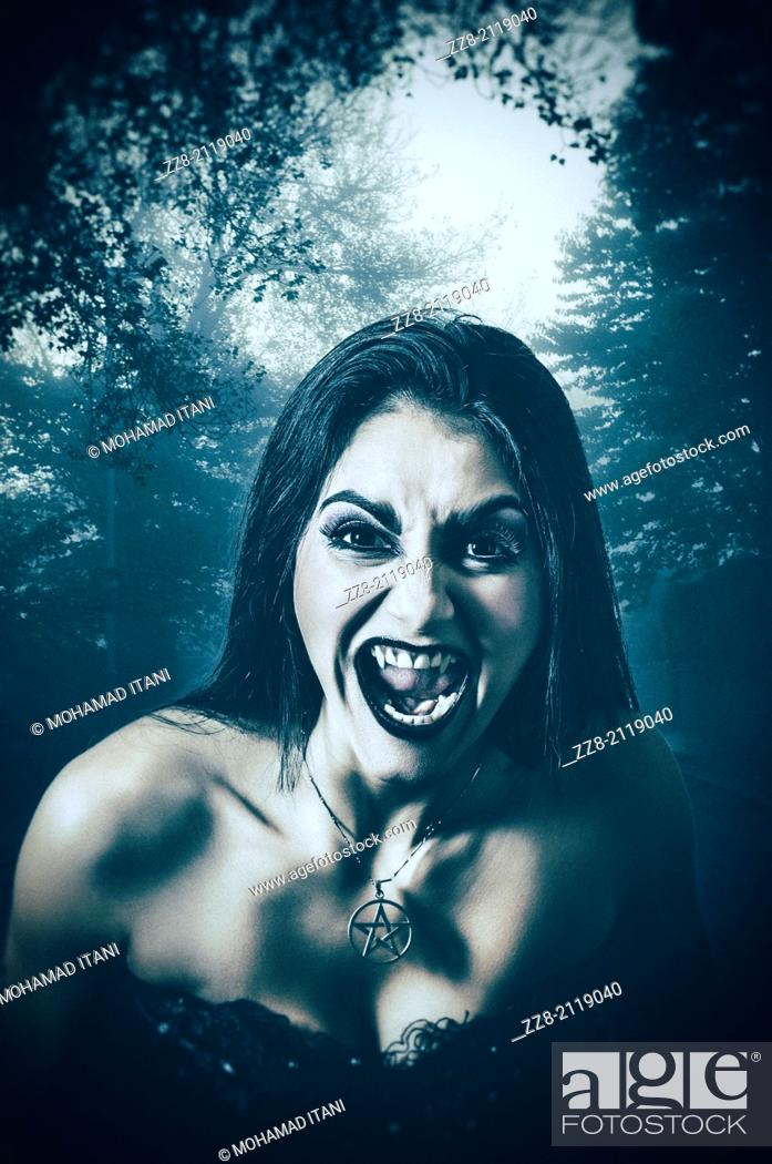 Stock Photo: Femaile vampire in the woods.