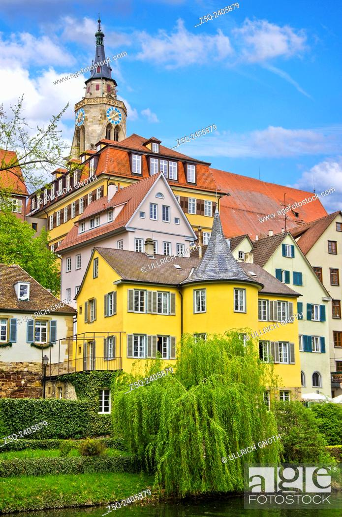 Stock Photo: The Neckar river waterfront of Tubingen, Germany, showing its landmarks the Collegiate Church and Holderlinturm tower.