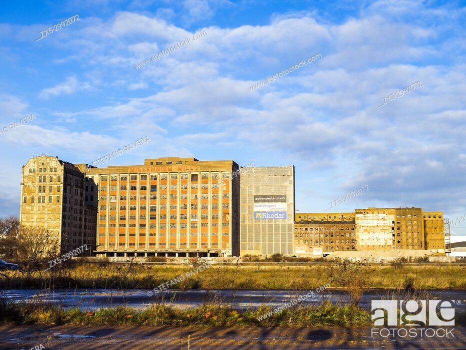 Stock Photo: The Millennium Mills is a derelict turn of the 20th century flour mill in West Silvertown on the south side of the Royal Victoria Dock - London, England.