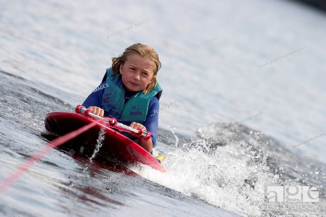 Stock Photo: Girl On Knee Board, Ontario.